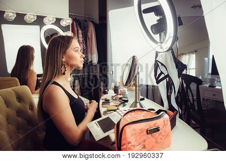 Beauty blogger woman doing makeup turtorial video for the online vlog
