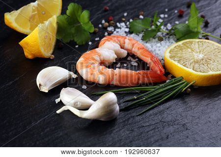 Delicious Sauteed Shrimp Heart With Cajun Seasoning And Lime On Dark Stone