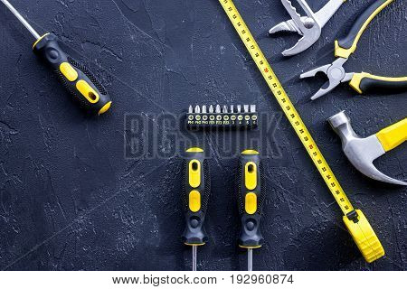 Set of construction tools on balck stone desk background top view.