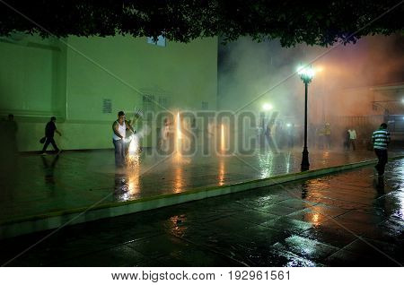 23Rd September 2014, Leon, Nicaragua - Men Setting Off Fireworks In The Street To Celebrate The Fest