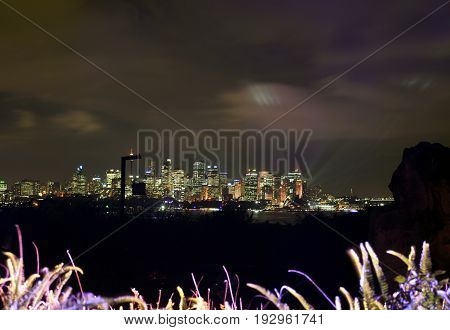 Sydney cityscape at night during Vivid Sydney light festival from Taronga Zoo. Free annual outdoor event of light music and ideas.