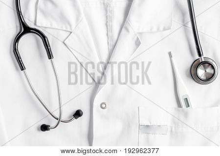 doctor's work desk in hospital with stethoscope on overall background top view