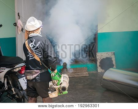Chiang Rai, Thailand - May 21, 2016 : Men Are Working Fogging To Eliminate Mosquito.