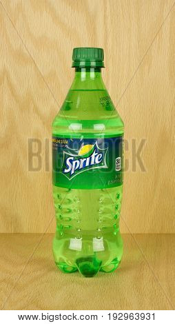 RIVER FALLS,WISCONSIN-JUNE 26,2017: A bottle of Sprite brand soda with a wood background.
