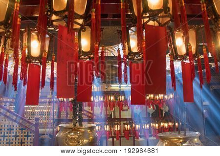 beautiful light of Man Mo Temple in Hong Kong with lamps and incense coils hang on the ceiling