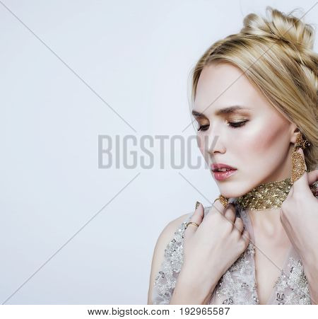 young pretty blond woman in luxury jewelry, lifestyle rich people concept close up