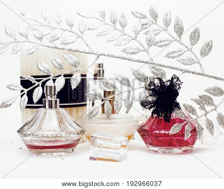 Jewelry table with lot of girl stuff on it, little mess in cosmetic brushes, women interior concept, perfume elegance things isolated close up