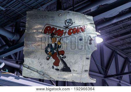 Oshkosh WI - 3 March 2017: A piece of nose art from WWII aircraft featuring Rum and Coke