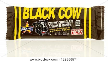 Winneconne WI -22 June 2017: A package of black cow chewy chocolate caramel candy on an isolated background