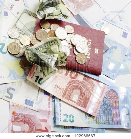 Cash on table isolated: dollars, euro, ruble broken money. All in mess, global crisis concept passport