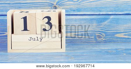 Vintage Photo, July 13Th. Date Of 13 July On Wooden Cube Calendar