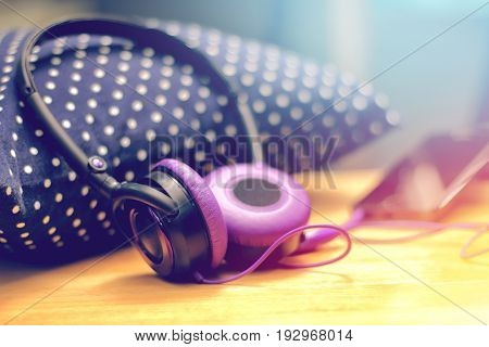 headphone lying on pillow for listening relax music with smartphone.