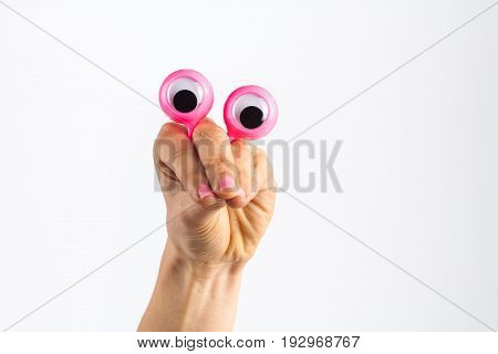 Funny Character Creature Looking Very Surprised And Scared, Depicted With Female Hand And Googly Eye