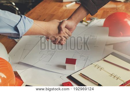 Engineer And Architect Concept, Engineer Architects Shaking Hand With Blueprints Background, Vintage