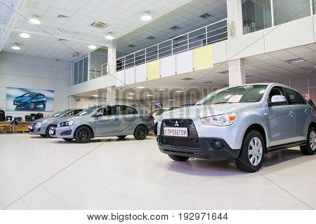 Russia Kirov - December 06 2016: Showroom of dealership Chevroled named Souz and car in it in Kirov city in 2016