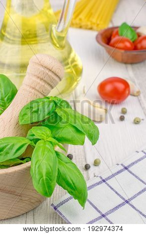 Traditional fresh ingredients for Italian cuisine on a rustic wooden background