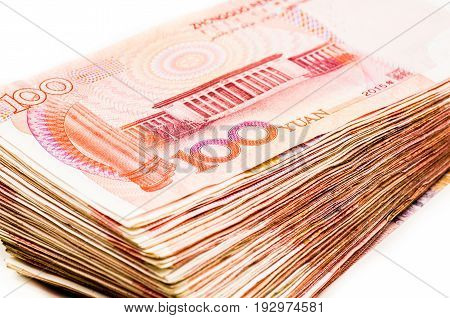 pile of chinese yuan bank notes on white background