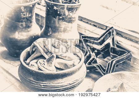 windowsill. many small pottery lying on the plate closeup. Creative studio potter. Workplace wizard Crock pottery