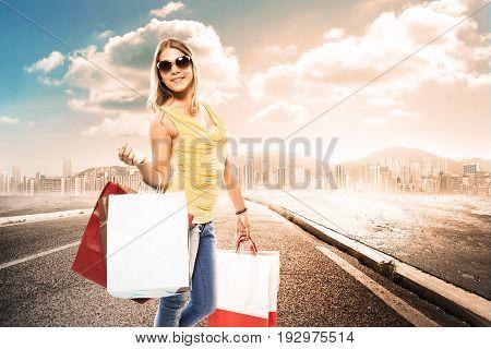 girls with shoppers walking far form a desert city