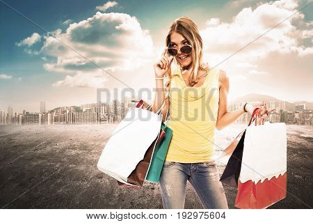 girls with sunglasses and shopper far away from city