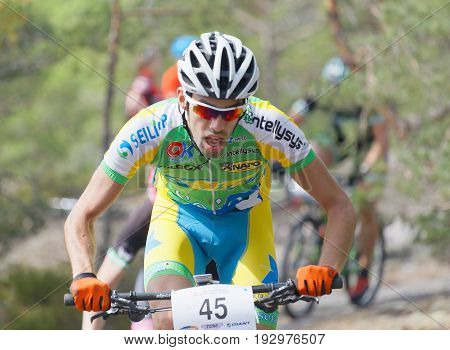 STOCKHOLM SWEDEN - JUNE 11 2017: Colorful group of mountain bike cyclists in the forest at Lida Loop Mountain bike Race. June 11 2017 in Stockholm Sweden