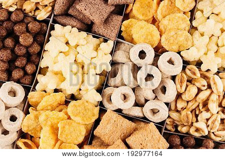 Corn flakes set - rings stars balls chocolate as decorative cereals background. Top view.