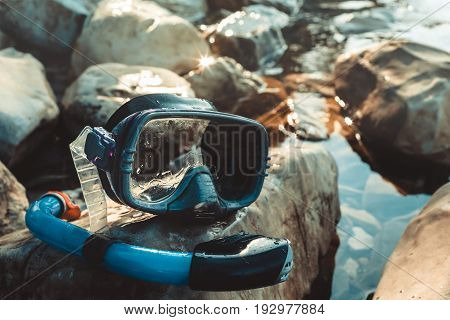 Mask For Freediving And Snorkel Lie On The Beach On The Rocks Closeup. Tourism And Travel Concept