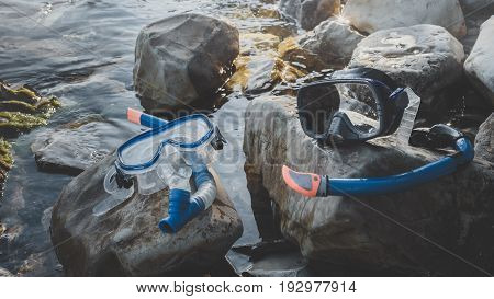 Diving Masks And Snorkel Lie on The Stones On Sea Background. Tourism Travel Freediving Concept