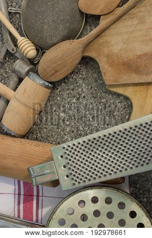 Rural kitchen utensils on vintage planked wood table from above - rustic background with free text space Free space in the shape of a heart.