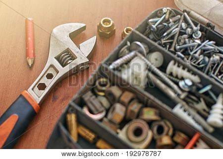 Used repair kit and adjustable wrench on the table