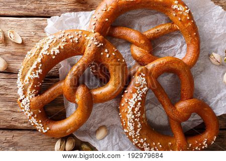 Freshly Baked Soft Pretzel With Generous Sprinkling Of Coarse Salt Close-up. Horizontal Top View