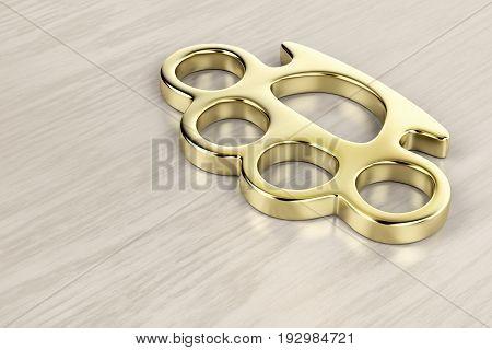 Golden brass knuckles on wooden background, 3D illustration