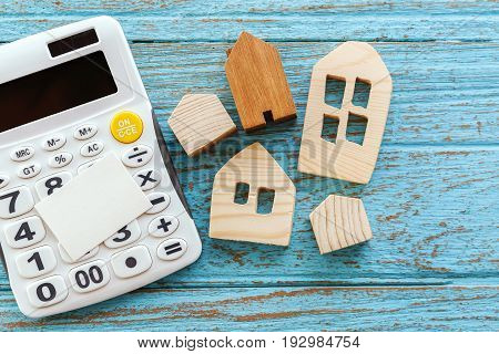 Calculator And Wood House With Blank Card