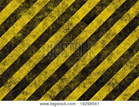 old grungy yellow hazard stripes on black road