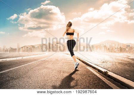 girl make jogging far from a metropolitan city
