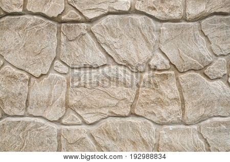 New decorative plaster imitating a stone wall closeup