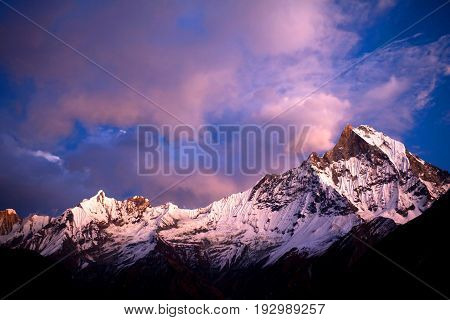 Mount Machapuchare (Fishtail) at sunset - view from Annapurna base camp. Machhapuchchare is a mountain in the Annapurna Himal of north Central Nepal.