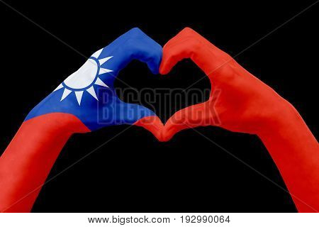 Hands flag of Taiwan shape a heart. Concept of country symbol isolated on black. Abstract 3d illustration graphic design with pattern and texture.