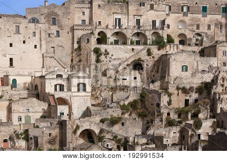 Ancient architecture of Sicilian mountain village fortress with the dense houses. Panoramic view of the borough, houses, windows, arches, terraces
