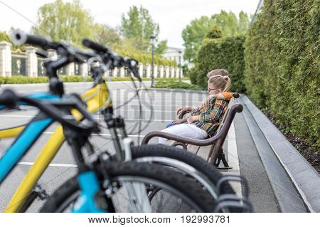 Little Kids Embrasing While Sitting On Bench At Park