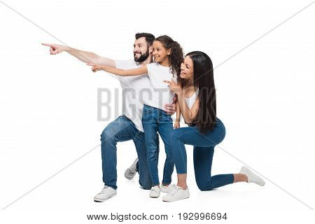 Smiling Multiethnic Family Together Pointing Away With Fingers Isolated On White