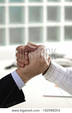 shaking hands for a businessmen getting an agreement