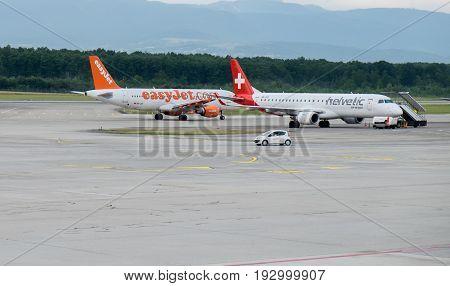 GENEVA SWITZERLAND - JUNE 25 2017: EasyJet and Helvetic Airways aircrafts landed at Geneva airport. Switzerland