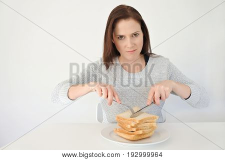 Young Woman Giving In To Her Urge And Craving To Carbohydrates