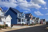 Generic, Colorful Houses on Suburban Neighborhood Street on a Sunny Day poster