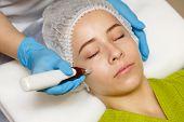 Hardware cosmetology. Mesotherapy. Dermapen. Treatment of cheek zone. Spa treatments. Face rejuvenation. poster