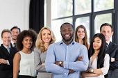 African American Businessman Boss With Group Of Business People In Creative Office, Successful Mix Race Man Leading Businesspeople Team Stand Folded Hands, Professional Staff Happy Smiling poster