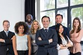Boss And Business People Group With Mature Leader On Foreground In Office, Leadership Concept, Successful Mix Race Team Of Businesspeople Wearing Suits, Professional Staff Happy Smiling poster