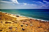 Holiday at the sea in a caravan, free camping on the beach with a motorhome poster