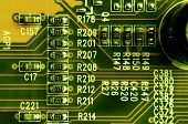 Close up of colored micro circuit board. Abstract technology background. Computer mechanism in details poster